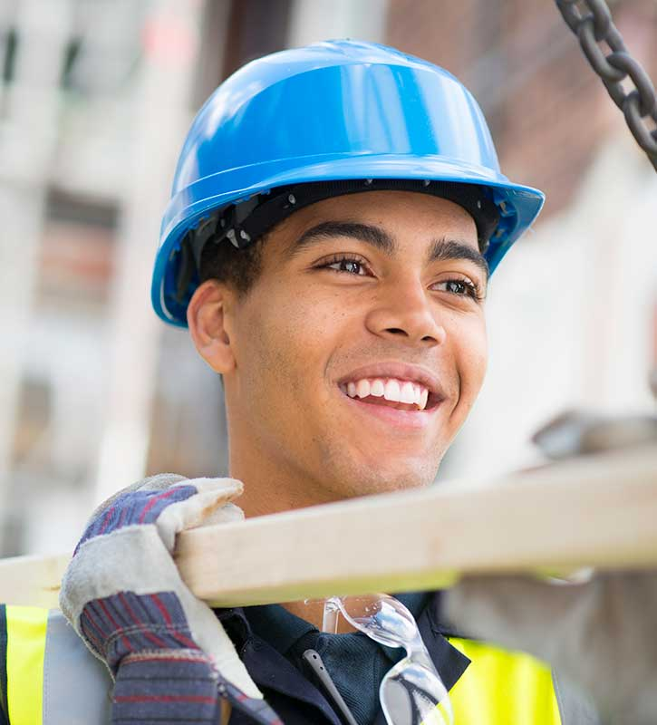 Young man wearing a hard hat